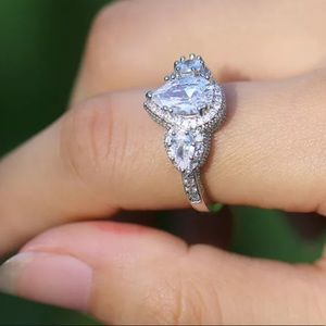 Pear shape women's silver engagement wedding ring